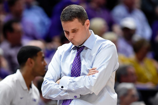 LSU head coach Will Wade thinks about the situation in the first half of an NCAA college basketball game, Tuesday, Feb. 18, 2020, in Baton Rouge, La. (AP Photo/Bill Feig)