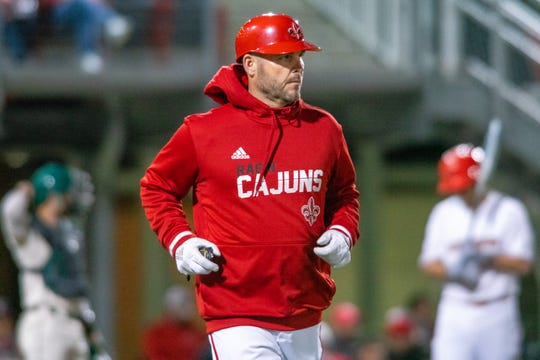 UL assistant coach Jeremy Talbot jogs to first base during a recent game against Tulane at The Tigue.