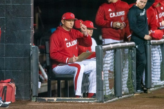 Ragin' Cajuns pitching coach B.J. Ryan, a former MLB All-Star, signals in a call from the dugout during UL's 9-6 loss to Tulane on Wednesday night at The Tigue.