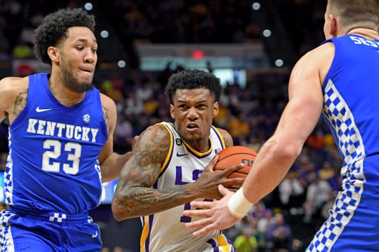 LSU guard Marlon Taylor, center, drives to the basket between Kentucky forwards EJ Montgomery (23) and Nate Sestina during the first half of an NCAA college basketball game Tuesday, Feb. 18, 2020, in Baton Rouge, La. (AP Photo/Bill Feig)