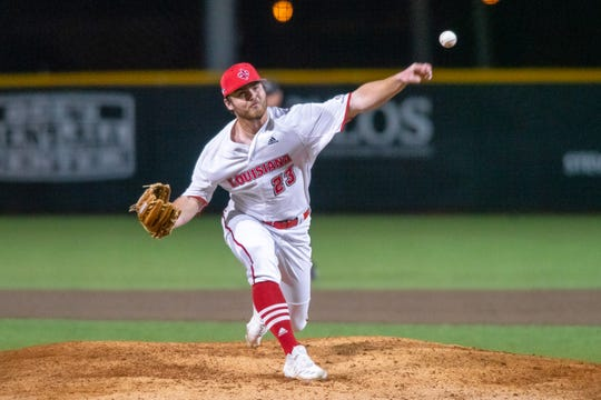 """UL's Brandon Talley throws to the batter as the Ragin' Cajuns take on the Tulane Green Wave at M.L. Tigue """"Moore"""" Field on Wednesday, Feb. 19, 2020."""