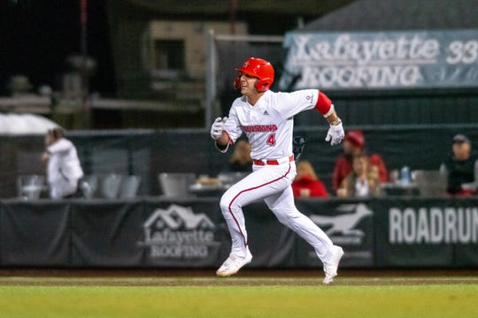 UL's Brennan Breaux sprints to second base after getting a hit in Wednesday night's 9-6 loss to Tulane. Breaux exited the game after tweaking a muscle on the play.
