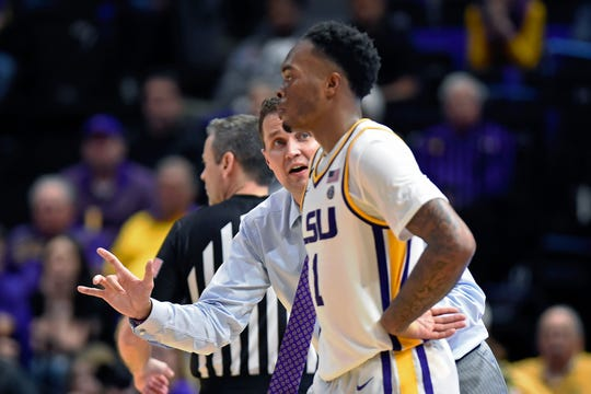LSU coach Will Wade talks strategy with LSU guard Javonte Smart late in the second half of the team's NCAA college basketball game against Kentucky, Tuesday, Feb. 18, 2020, in Baton Rouge, La. Kentucky won 79-76. (AP Photo/Bill Feig)