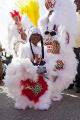 A young Mardi Gras Indian, a tradition that dates back to slavery, wears an intricate hand-made costume on Mardi Gras Day on Feb. 21, 2012, in New Orleans, Louisiana.