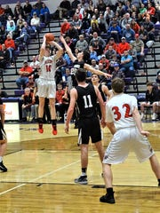 Fairfield Union's Charlie Bean takes a shot over a River Valley defender during the Falcons' 59-36 tournament win Wednesday night.