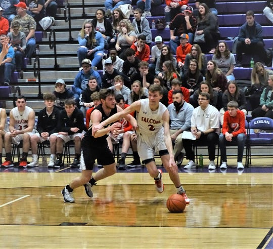 Fairfield Union's Chase Poston dribbles past a River Valley defender during the Falcons' 59-36 win tournament victory Wednesday night.