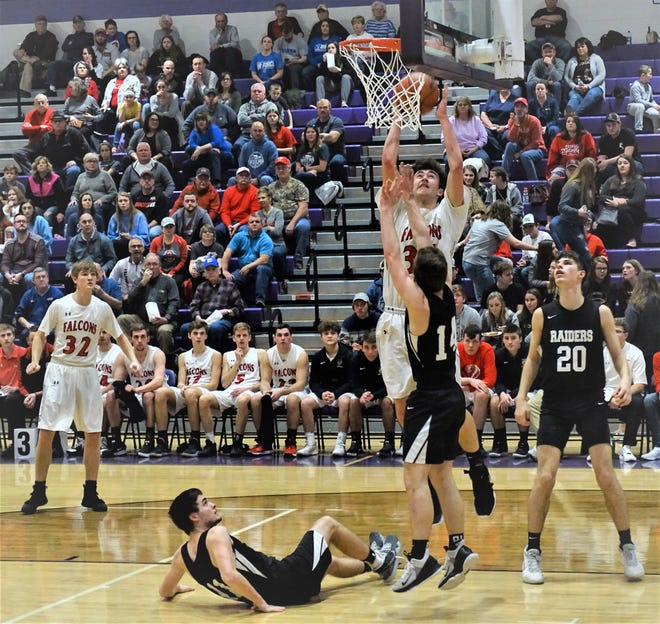 Fairfield Union's Huston Harrah goes up for two of his 19 points during the Falcons' 59-36 Division II sectional tournament win over River Valley.