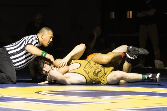 Brighton's Dane Donabedian controls Holt's Ian Smith on his way to an 11-0 victory in the 171-pound match in the regional final on Wednesday, Feb. 19, 2020 in Grand Ledge.