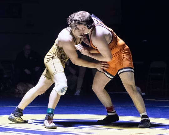 Brighton's Harley Berne (right) won an overtime decision over Holt's Adam Russell at 189 pounds in the team regional final on Wednesday, Feb. 19, 2020 in Grand Ledge.