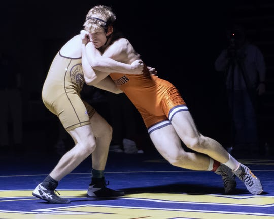 Brighton's Greyson Stevens (right) pinned Holt's Fritz Terrill at 215 pounds in the team regional championship match on Wednesday, Feb. 19, 2020 in Grand Ledge.