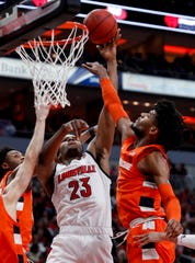 Louisville's Steven Enoch goes up hard against Syracuse's Quincy Guerrier on Feb.19, 2020.