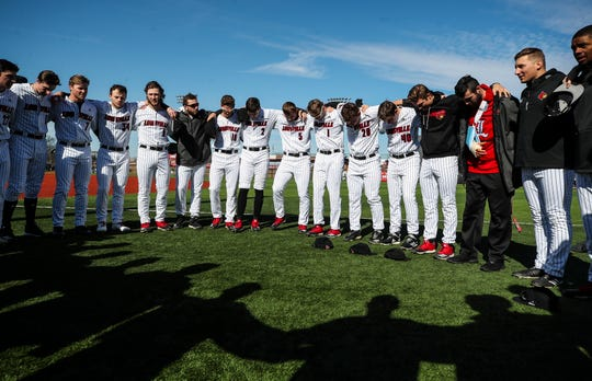 "The entire Louisville team takes a moment before the home opening game February 19. ""The players break down with finish every day, because I'm sure it's about finishing in Omaha and finishing with a national championship,"" said Louisville coach Dan McDonnell. ""It's clear, let's go get No. 2, but it didn't happen today. Friday will be let's go get No. 2, again, because it's silly to talk about all those things in the distance. We have to get better this weekend."""