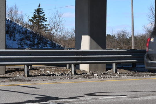 Chunks of fallen concrete can be seen below the Barnes Road bridge on  U.S. 127 northbound on Thursday Feb. 20, 2020.  A Jackson woman was injured Wednesday after a piece of concrete from the bridge broke free and went through her windshield, striking her in the head, the Ingham County Sheriff's Office said.