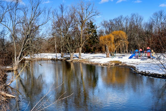 The level of the Red Cedar River from the vantage point of Wonch Park on Thursday, Feb. 20, 2020, in Okemos.