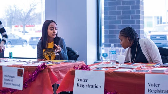 Annetta Sumler of Michigan Student Power Network speaks with Brittney Gordy during the Lansing Black the Vote event on Feb. 15, 2020.