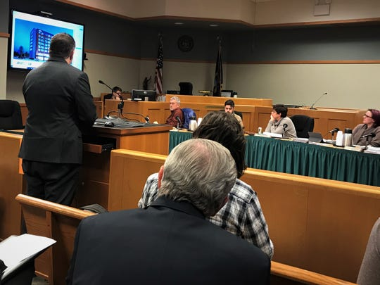Dave Mefford, an architect with Neumann Smith, presents updated renderings to the East Lansing City Council on Tuesday, Feb. 18, 2020.