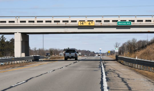 The Barnes Road overpass seen from U.S. 127 north on Thursday, Feb. 20, 2020.A Jackson woman was injured Wednesday after a piece of concrete from the bridge broke free and went through her windshield, Ingham County Sheriff's Office officials said.