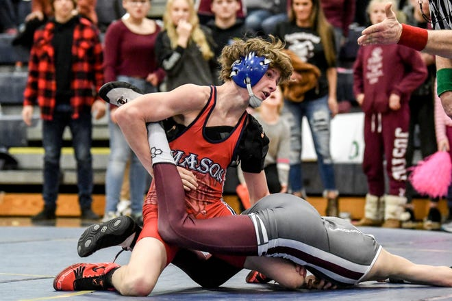Mason's Tayden Miller, top, wrestles with Eaton Rapids' Jay Shaull in their 103-pound weight class match on Wednesday, Feb. 19, 2020, at Chelsea High School. Miller won the match.