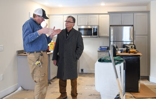 Eaton County Treasurer Bob Robinson, right, chats with T.A. Forsberg Construction Manager Brindley Byrd, Thursday, Feb. 20, 2020, about ongoing construction in Eaton Village.