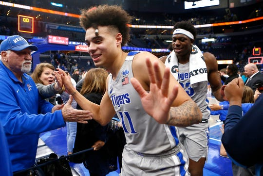 Memphis Tigers guard 	Lester Quinones and center 	Malcolm Dandridge high-five fans after their 77-73 win over the East Carolina Pirates at the FedExForum on Wednesday, Feb. 19, 2020.