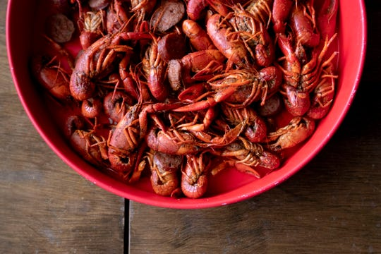 Crawfish sit in a tray Wednesday, Feb. 19, 2020, at Crossroads Seafood in Hernando.