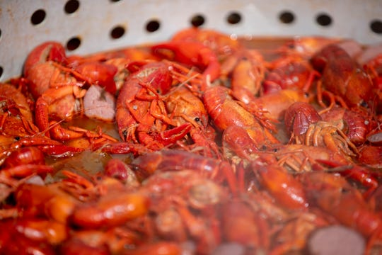 Crawfish cook in a pot Wednesday, Feb. 19, 2020, at Crossroads Seafood in Hernando.