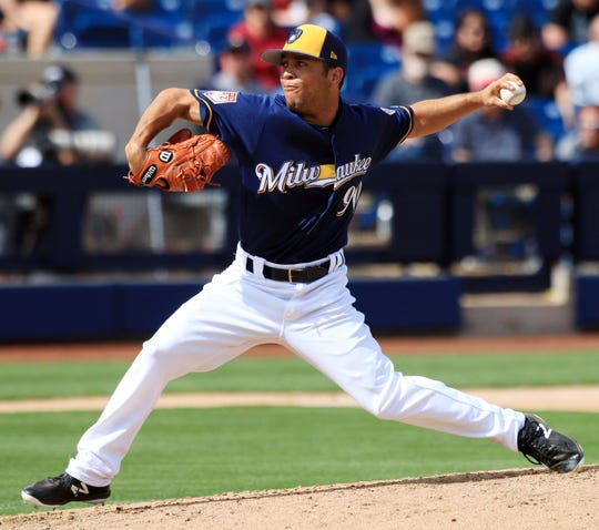 Milwaukee Brewers minor league pitcher Clayton Andrews delivers a pitch during their spring training game against the Arizona Diamondbacks.