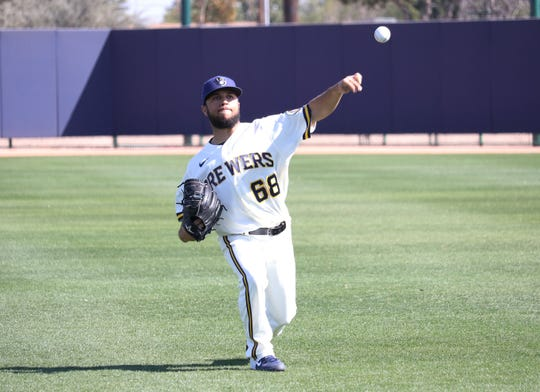 Milwaukee Brewers non-roster invitee Clayton Andrews throws during spring training Monday.
