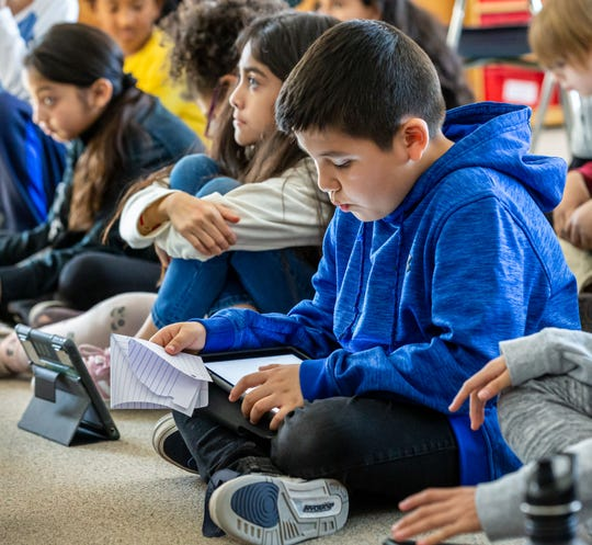 Third-grader Christian Montesinos works through a lesson plan on his iPad at Pershing Elementary on Wednesday, Feb. 19, 2020.