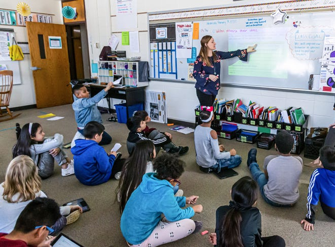 ESL (English as a Second Language) teacher Alissa Sawyer works with students during class at Pershing Elementary on Wednesday, Feb. 19, 2020.