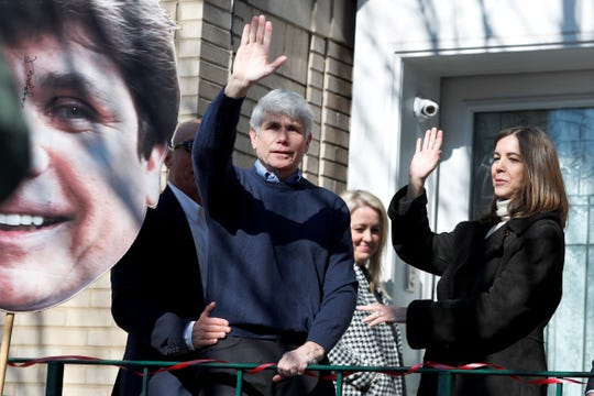 Former Illinois Gov. Rod Blagojevich and his wife Patti wave to supporters after a news conference outside his home Wednesday, Feb. 19, 2020, in Chicago. On Tuesday, President Donald Trump commuted his 14-year prison sentence for political corruption.