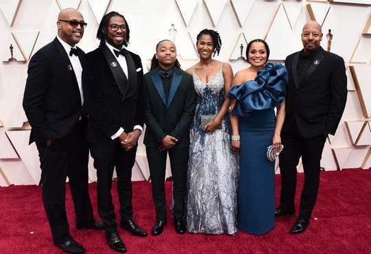 "Matthew A. Cherry, from second left, Deandre Arnold, Karen Rupert Tolliver, Sandy Arnold, second right, and the cast and the crew of ""Hair Love"" arrive at the Oscars on Sunday, Feb. 9, 2020, at the Dolby Theatre in Los Angeles. (Photo by Jordan Strauss/Invision/AP)"