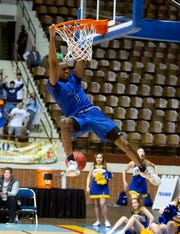 Catholic's Justin Bufford (1) dunks in the last second of the game against Montevallo in the AHSAA Regional Championship.