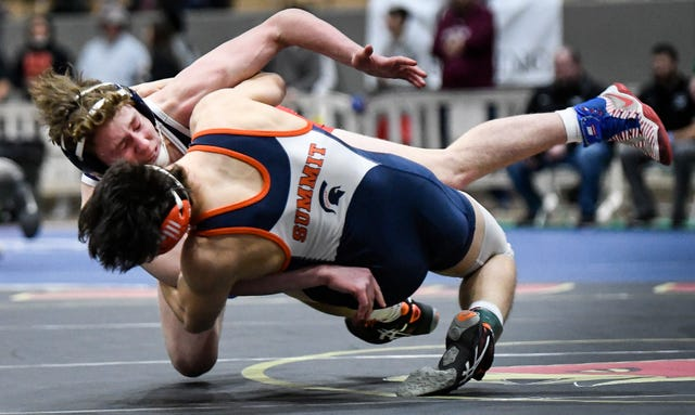 Summit's Miles Grady flips Oakland's Evan Harris to the mat during the TSSAA individual wrestling state championships at Williamson Co. Ag Center Thursday, Feb. 20, 2020 in Franklin, Tenn.