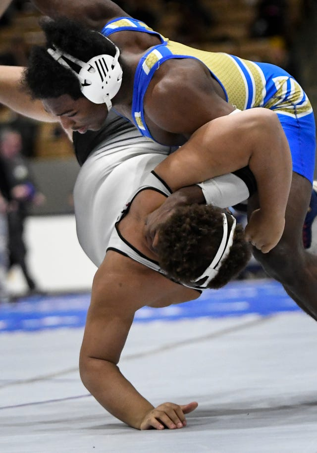 Brentwood's Skylar Coffey slams Tullahoma's Tydrell Mitchel to the mat during the TSSAA individual wrestling state championships at Williamson Co. Ag Center Thursday, Feb. 20, 2020 in Franklin, Tenn.