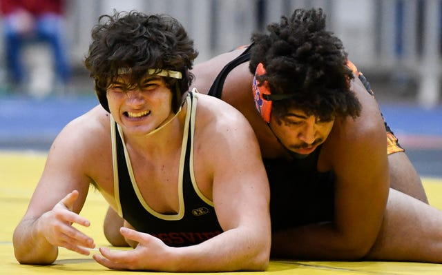 Rossview'a Brett Hill grimaces as he wrestles Blackman's Jaylan Hughes during the TSSAA individual wrestling state championships at Williamson Co. Ag Center Thursday, Feb. 20, 2020 in Franklin, Tenn.
