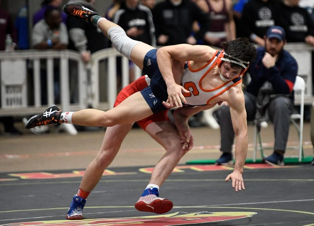 Oakland's Evan Harris takes Summit's Miles Grady to the mat during the TSSAA individual wrestling state championships at Williamson Co. Ag Center Thursday, Feb. 20, 2020 in Franklin, Tenn.