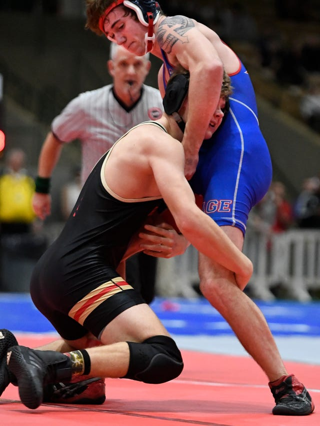 Rossview's Zachary Duessler tries to get away from Page's Ezra Chrisman during the TSSAA individual wrestling state championships at Williamson Co. Ag Center Thursday, Feb. 20, 2020 in Franklin, Tenn.