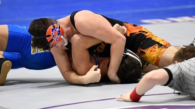 Blackman's Brooks Sacharczyk pins Brentwood's Alikhjan Makhamadaliev during the TSSAA individual wrestling state championships at Williamson Co. Ag Center Thursday, Feb. 20, 2020 in Franklin, Tenn.