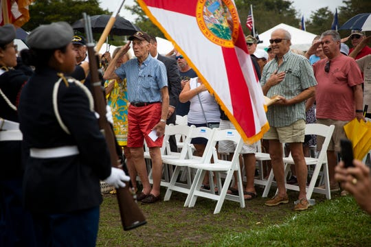 Attendees stand for the Presentation of Colors during a welcoming ceremony for the Wall That Heals at Veterans' Community Park in Marco Island on Thursday, February 20, 2020.