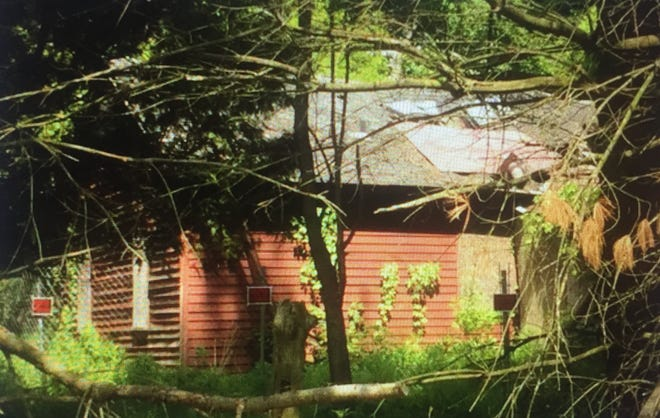 This derelict house, vacant since 2008, was likely headed toward demolition, but a new purchase agreement could give it new life.