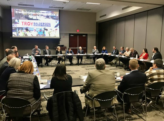 Congressman Troy Balderson, R-Zanesville, listens to 32 local, county and state officials Wednesday at the Reese Center on the Newark campus of the Ohio State University and Central Ohio Technical College.