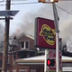 A home in Clifton, located next to a gas station, caught fire, prompting a massive response.