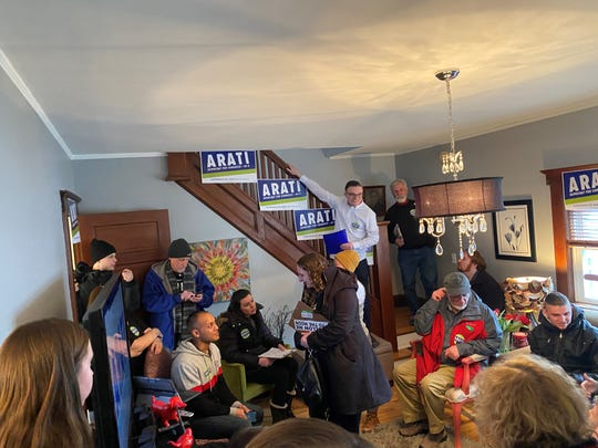 Volunteers gather ahead of a canvass launch Sunday, Feb. 16, 2020.