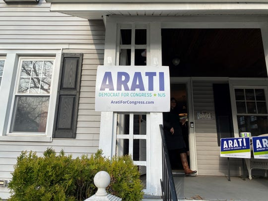 Campaign signs are displayed on a house Sunday, Feb. 16, 2020.