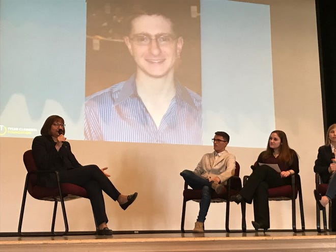 Jane Clementi addresses Ramsey High School students with a photo of her son Tyler in the background. Tyler's suicide in 2010 following a bullying incident at college sparked a national conversation on the impact of harassment on student lives.