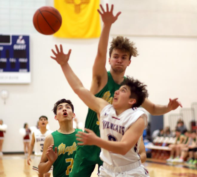 Junior Wildcat Adan Lozoya came off the bench to pump in 10 points and shine at the defensive end during Tuesday's 74-71 loss to the Mayfield High Trojans. Lozoya was one of four 'Cats in double-figure scoring.