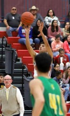 Senior Wildcat Ramiro Saenz nailed this 37-foot 3-pointer from just inside the half court line to beat the first-half horn.
