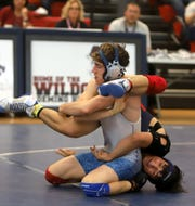 Senior Las Cruces High wrestler David Graves (top) says he is re-focused and ready to compete at the Class 5A State Wrestling Tournament as the No. 1 seed at 145 pounds .