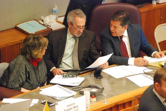 Senate Bill 5 sponsors Sen. Joseph Cervantes, D-Las Cruces, right, and Reps. Daymon Ely, center, D-Corrales, and Joy Garratt, left, D-Albuquerque, during a floor debate at the New Mexico state Senate on Friday, Feb. 7, 2020.